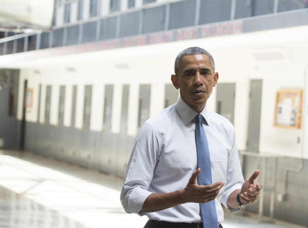Obama speaks to reporters during a tour of an Oklahoma prison in July <em>Saul Loeb/Getty</em>