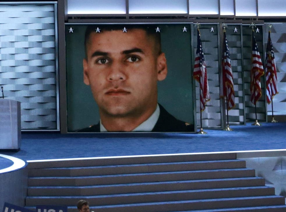 An image of fallen U.S. Army Capt. Humayun S. M. Khan is displayed on a screen as his father Khizr Khan delivers remarks on the fourth day of the Democratic National Convention