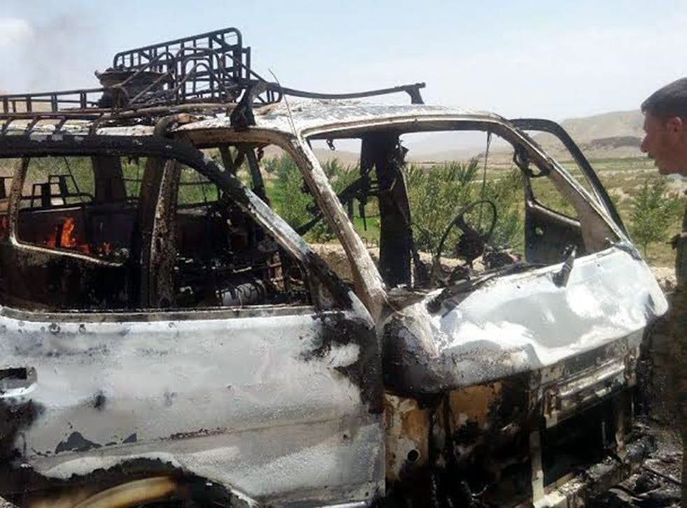 The van that is believed to have been transporting foreign tourists after it was hit by a rocket propelled grenade in Afghanistan