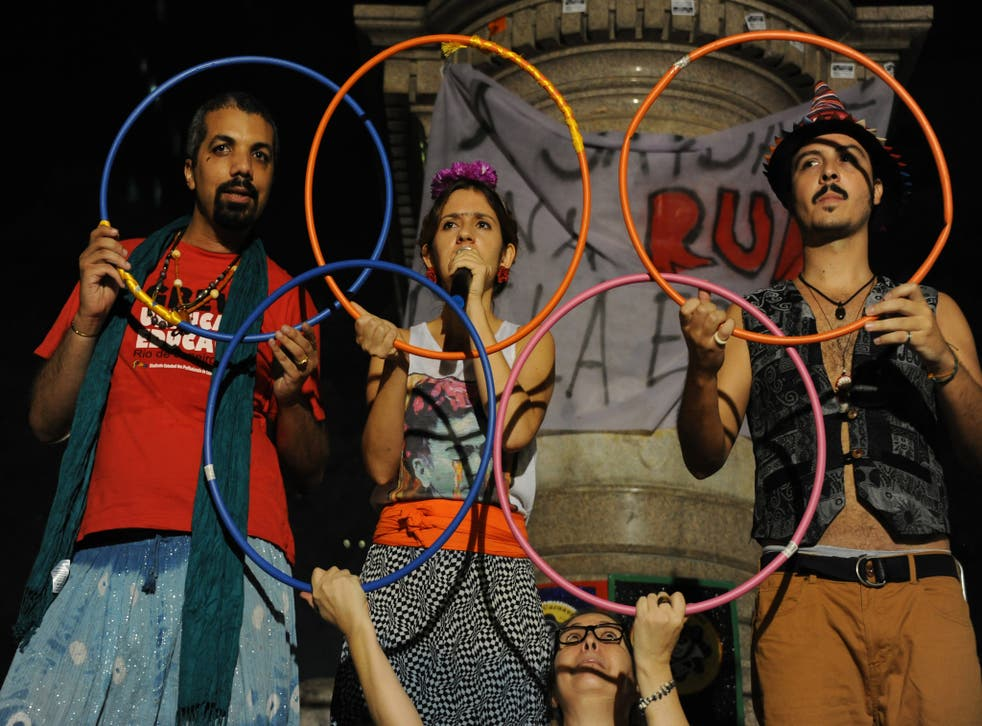 Rio residents celebrate the arrival of the Olympics but it is an occasion which is unlikely to benefit them greatly