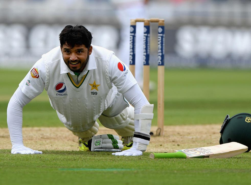 Pakistan's Azhar Ali celebrates his century with press ups during day two of the third Test at Edgbaston