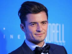 Radio 1 apologises after Orlando Bloom says 'pikey' live on air