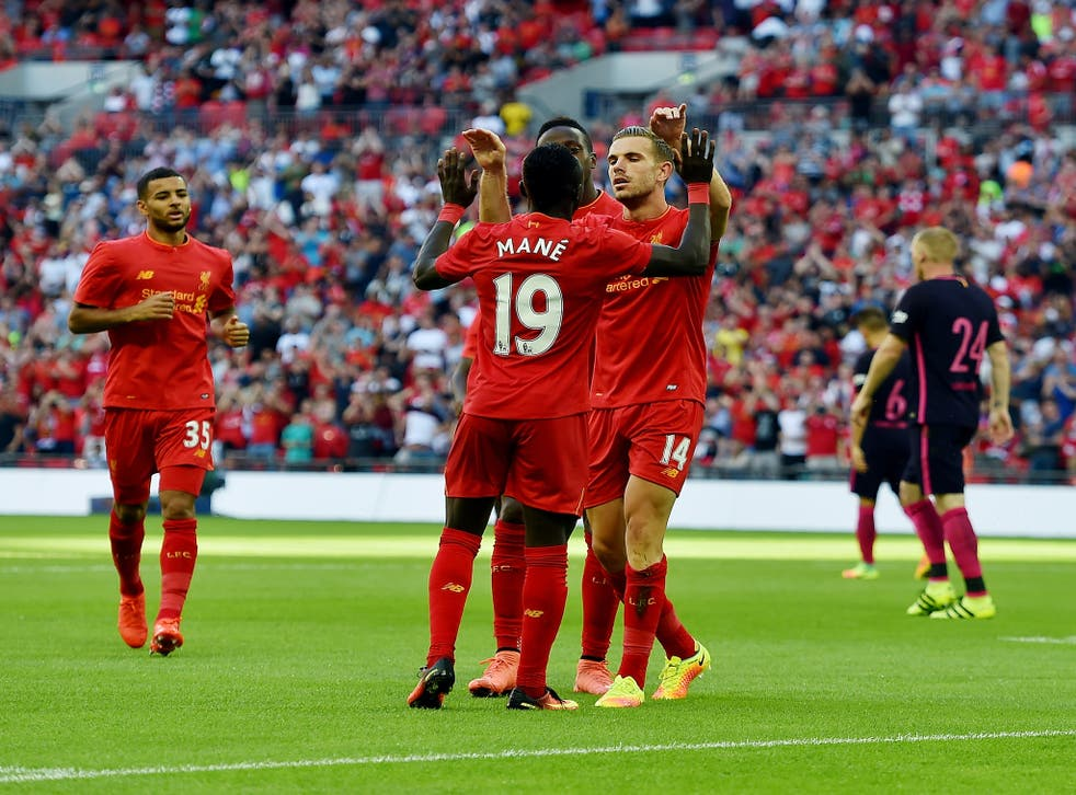 Sadio Mane is congratulated after scoring Liverpool's opener at Wembley