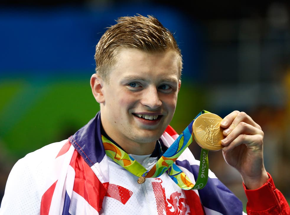Peaty shows off his gold medal with pride