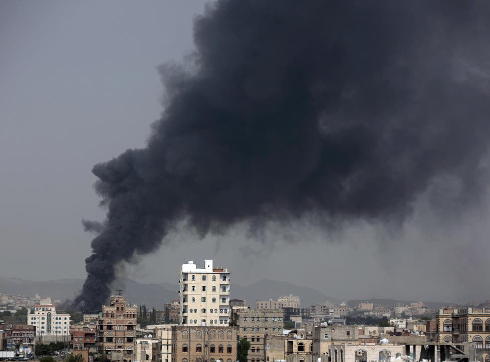 Smoke rises from a food factory in Sanaa where 14 workers were killed
