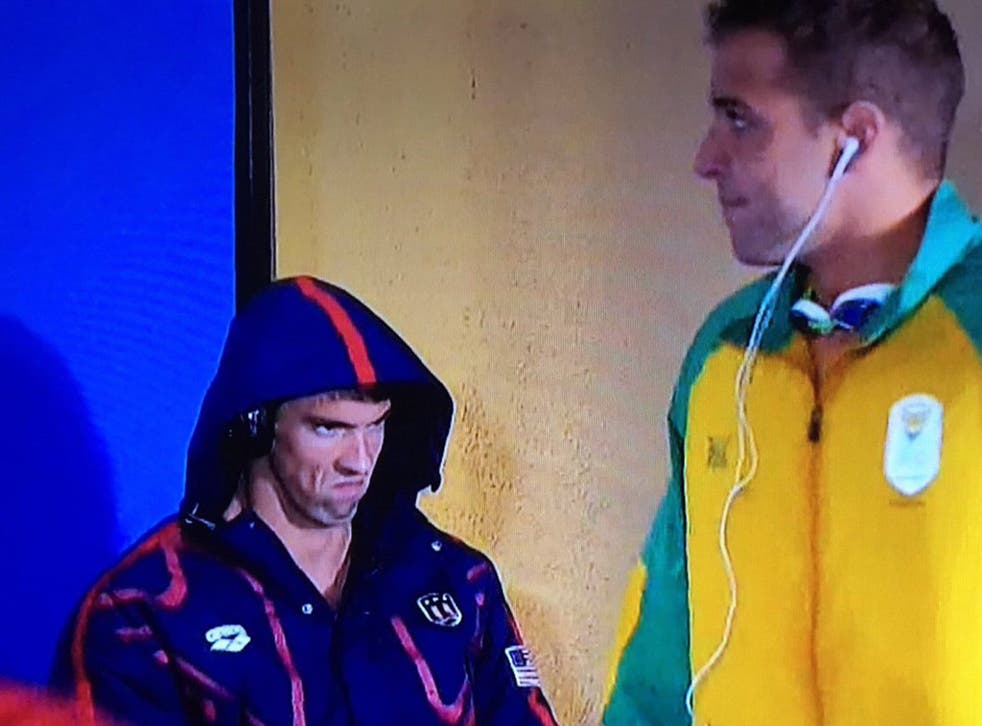 Michael Phelps glares at Chad le Clos minutes before their 200m butterfly semi-final