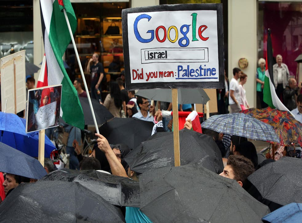 Demonstrators hold a placard reading 'Google Israel - did you mean Palestine' during a rally for Al-Quds Day, an event intended to express solidarity with the Palestinian people, on July 25, 2014 in Berlin, Germany