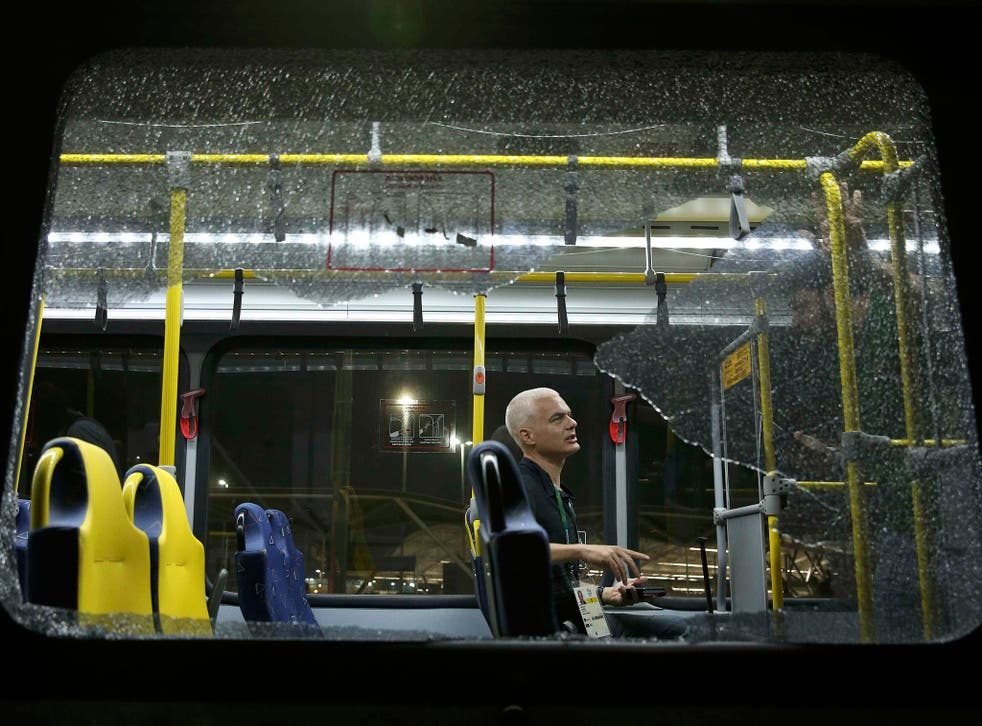 A broken window on an official media bus after it shattered when driving journalists to the main Olympic Park from Deodoro in Rio de Janeiro on 9 August