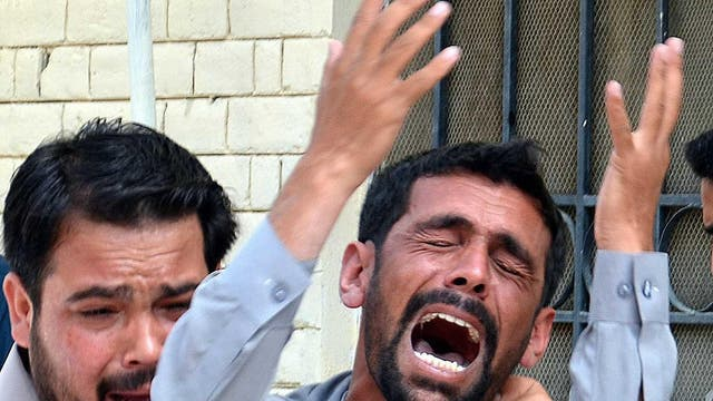 A man reacts after his relative was killed in a bomb blast in restive Quetta