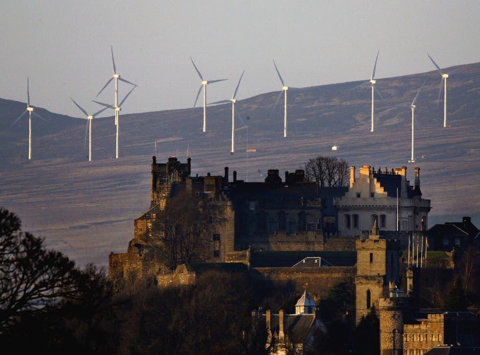 Wind turbines on hills behind Stirling Castle