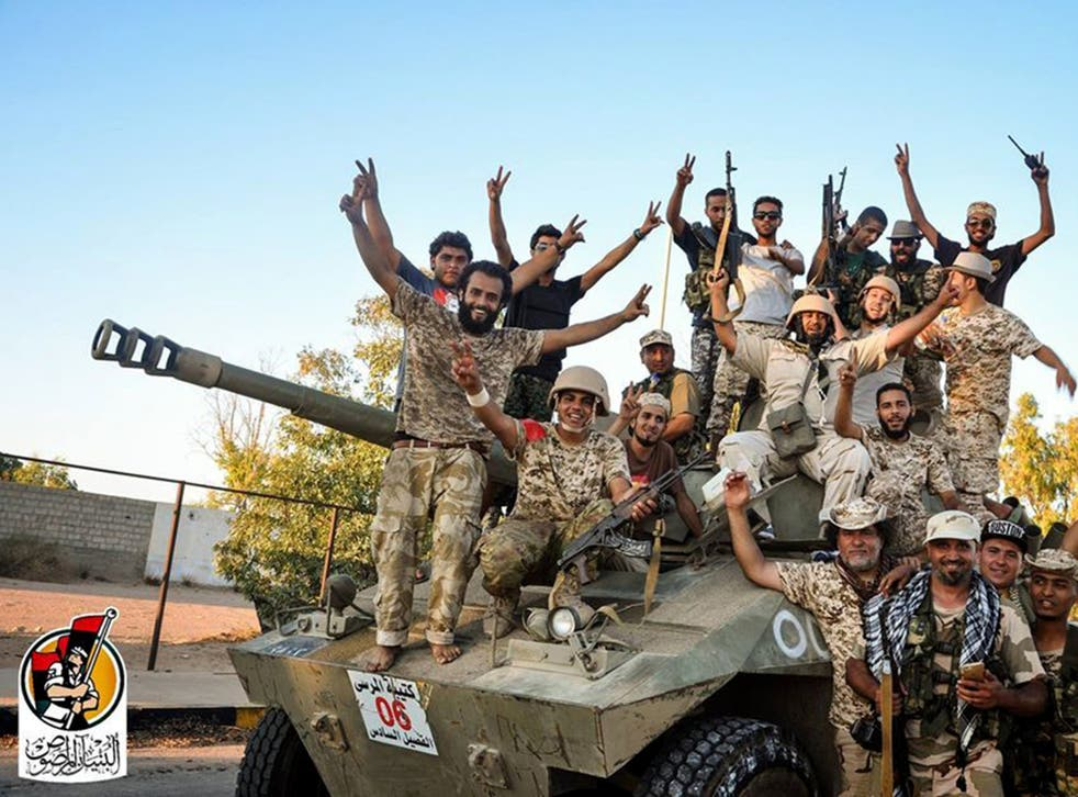 US backed forces celebrate re-taking Sirte, Libya from Isis