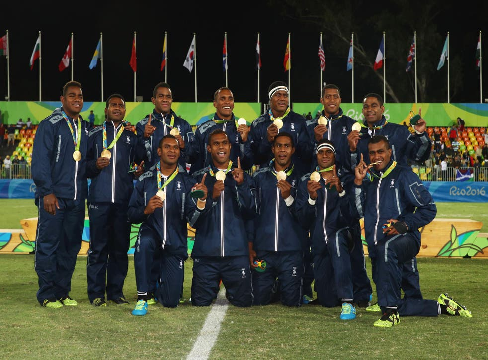 The Fiji rugby sevens team with their gold medals