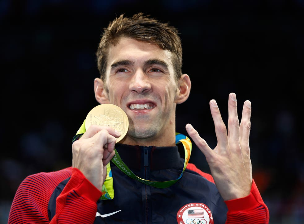 Phelps poses with his 22nd Olympic gold medal