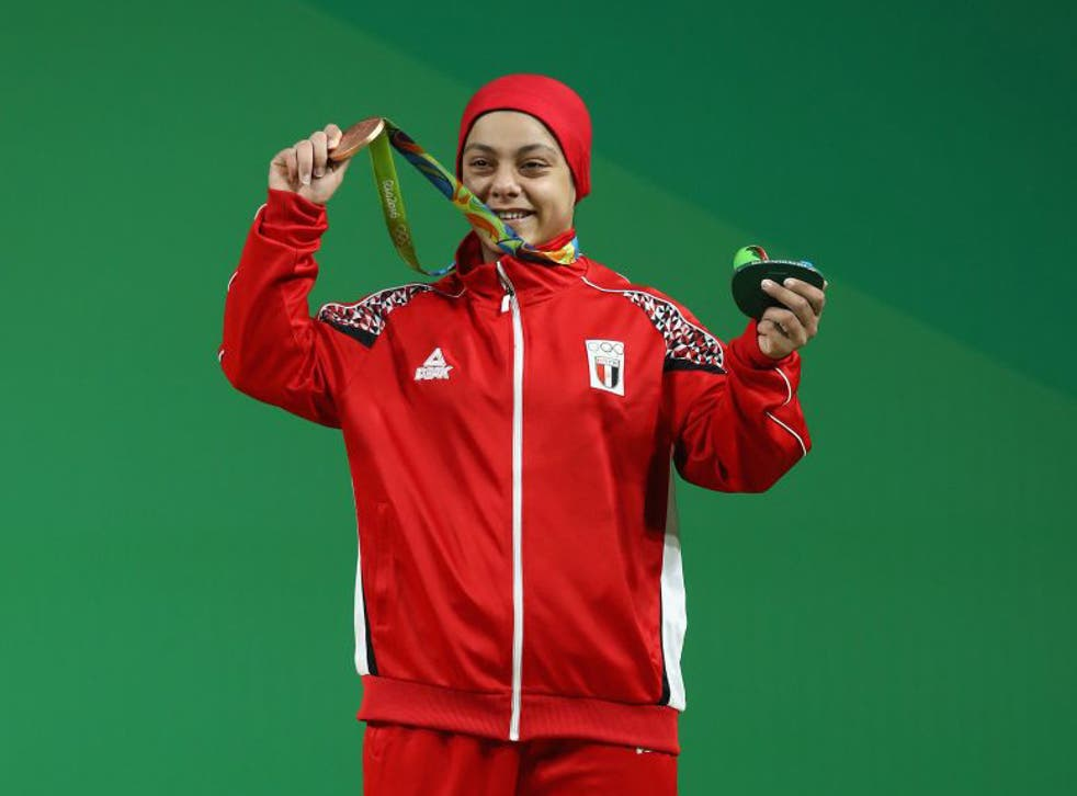 Sara Ahmed of Egypt holds up her bronze medal