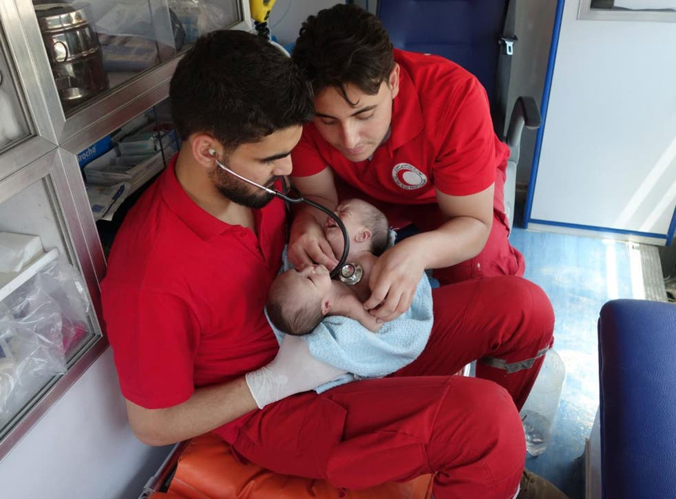 Conjoined twins Moaz and Nawaz being evacuated from Ghouta to Damascus by the Syrian Arab Red Crescent on 12 August
