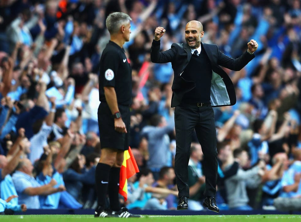 Pep Guardiola celebrates after Paddy McNair's own-goal gave Manchester City victory over Sunderland