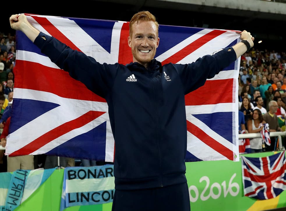 Greg Rutherford celebrates after clinching bronze in the men's long jump