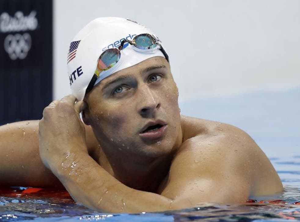 United States' Ryan Lochte checks his time in a men's 4x200-meter freestyle heat