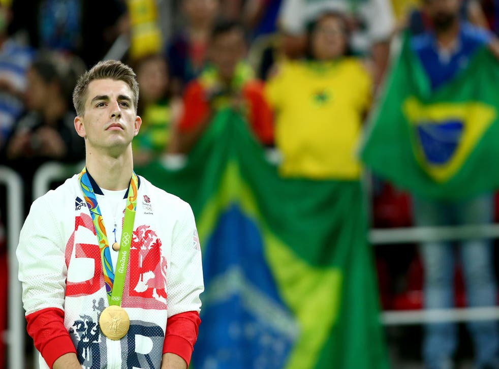 Gold medalist Max Whitlock of Great Britain stands on the podium at the medal ceremony for Men's Floor Exercise