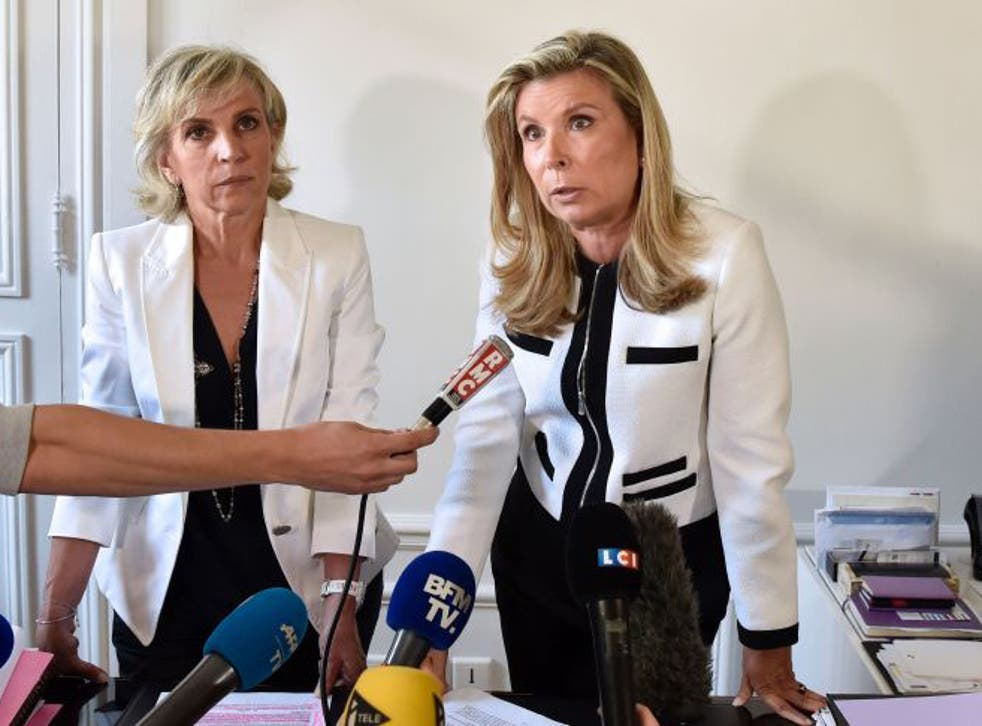 Janine Bonaggiunta (L) and Nathalie Tomasini (R), lawyers representing Jacqueline Sauvage, a woman convicted of the murder of her husband