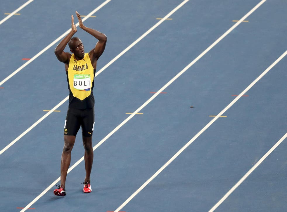 Usain Bolt wins his third consecutive Olympic gold medal in the men's 100m