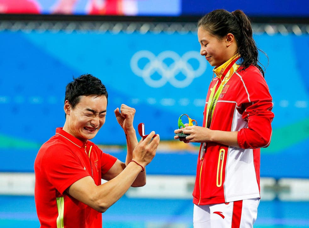 He Zi of China receives a marriage proposal from Chinese diver Ki Qin after winning the silver medal in the women's 3m Springboard final at Rio
