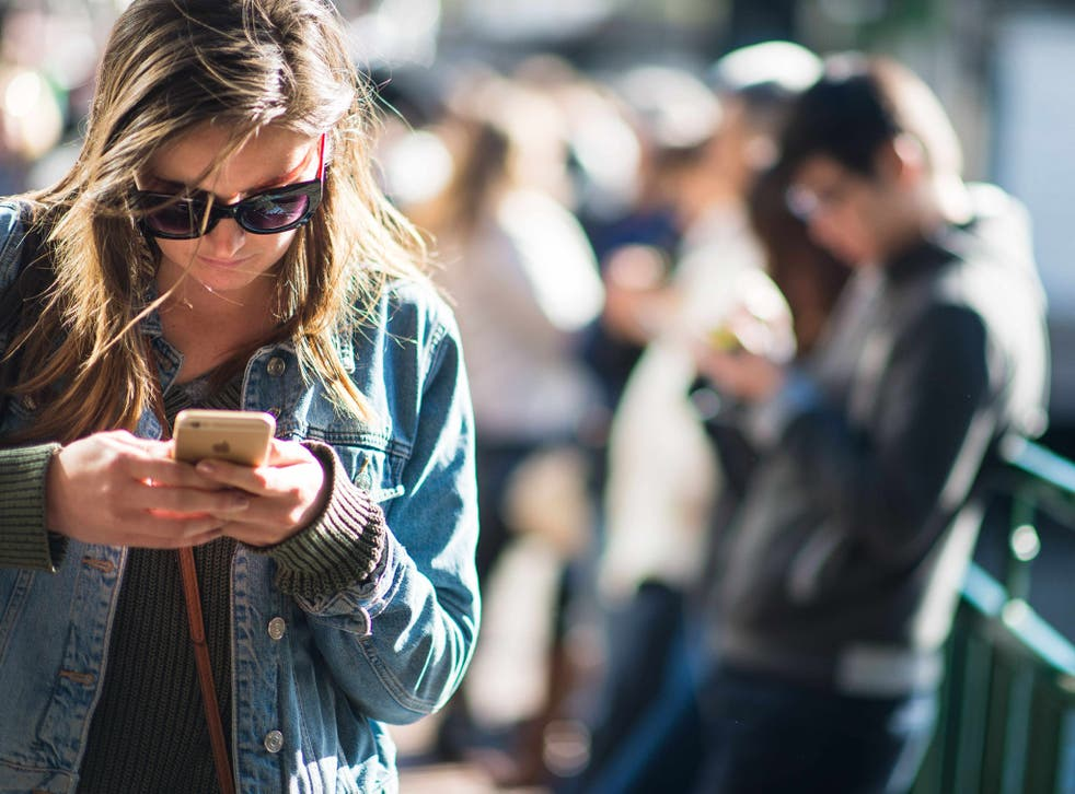 Mobile gamers immersed in an app