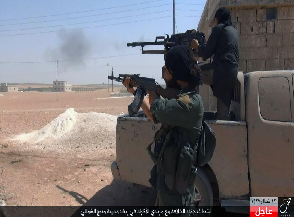 Isis fighters open fire during clashes in Manbij, Aleppo province, in an undated image posted online by their supporters
