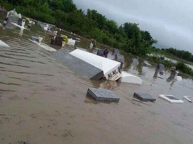 Louisiana flooding: Coffins seen floating down the streets