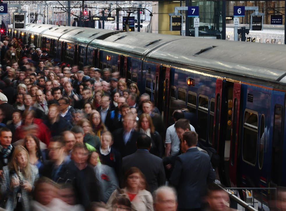 Passengers disembark a train at King's Cross station on November 7, 2014 in London, England