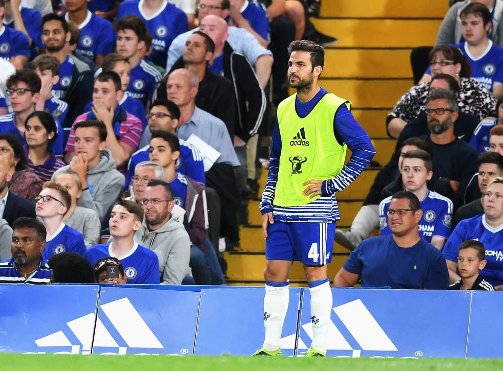 Cesc Fabregas watches from the side-line
