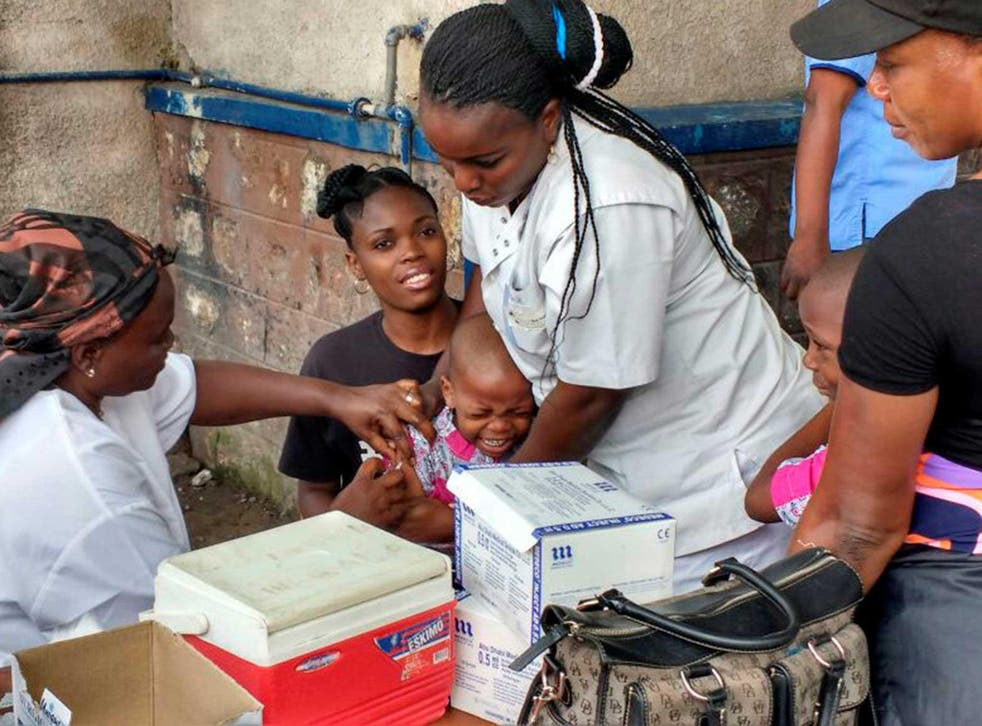 A Congolese child receives vaccination against yellow fever at the Kalembe-Lembe pediatric hospital, in Lingwala district of the Democratic Republic of Congo's capital Kinshasa