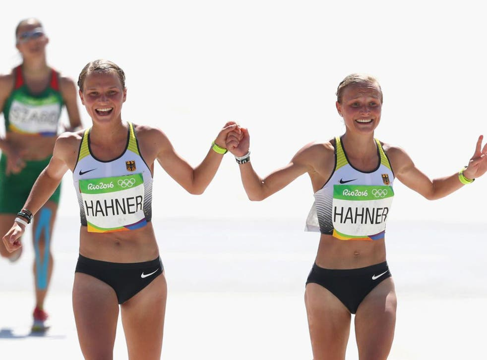 The twins received criticism for joining hands as they approached the finish line