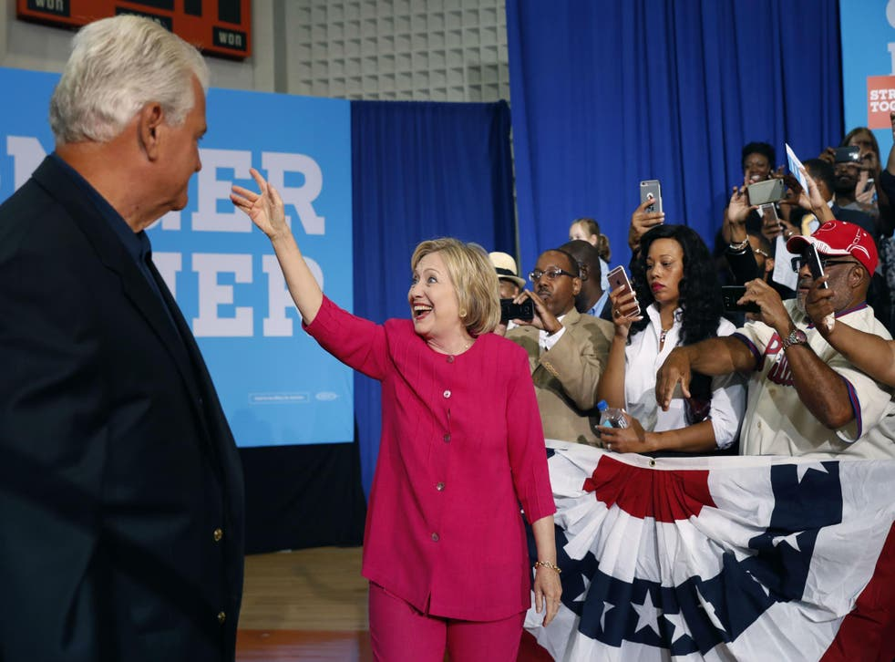 Ms Clinton waves to her supporters after a rally