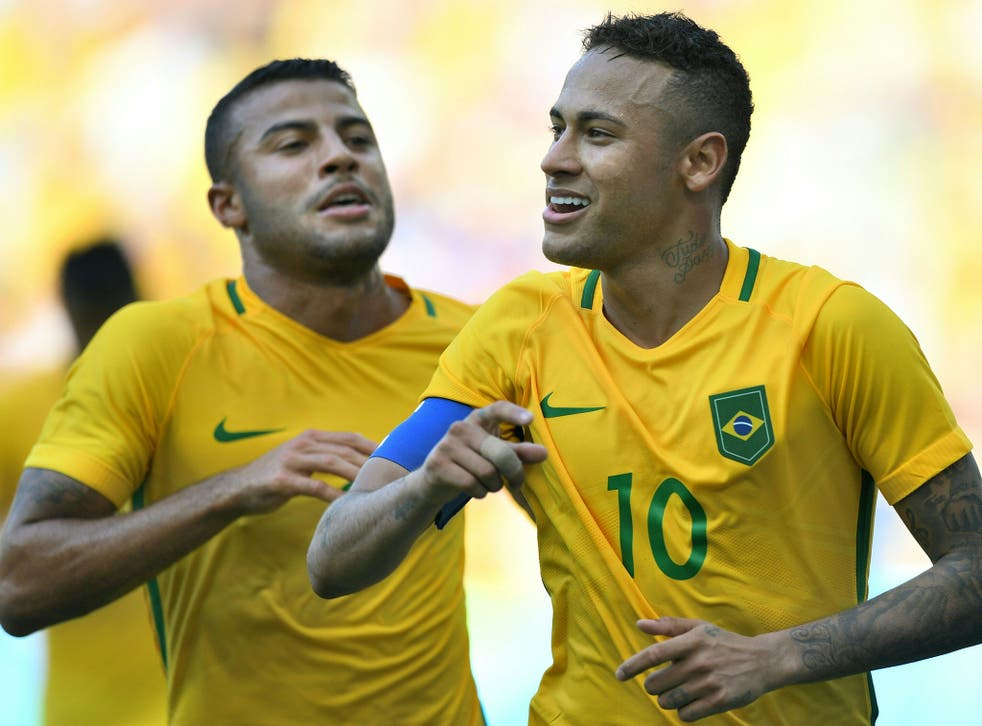 Neymar celebrates wrapping up Brazil's win with a late penalty