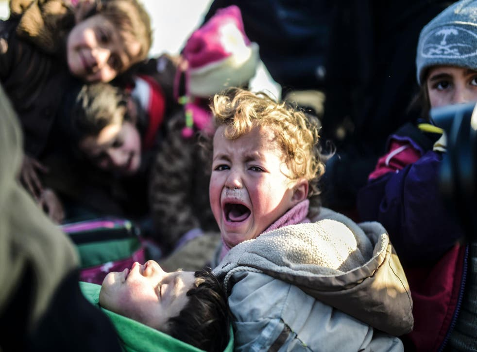 A Syrian child cries while fleeing the northern embattled city of Aleppo