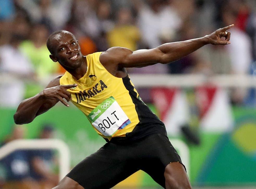 Bolt celebrates in his trademark 'lightning bolt' stance