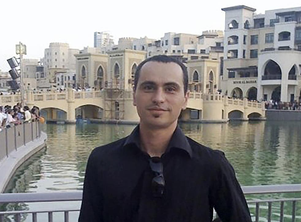 Scott Richards, pictured in Dubai, has been detained for highlighting the work of an Afghan refugee charity