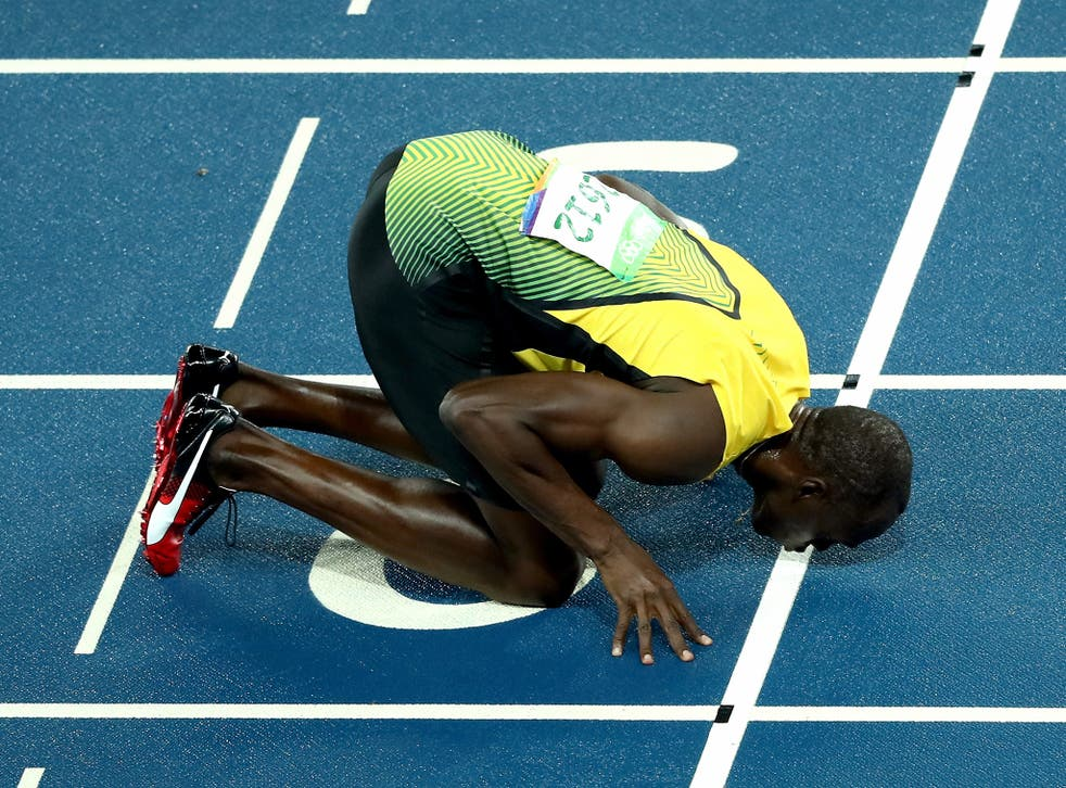 Usain Bolt kisses the finish line in his farewell to running the 200m at the Olympics