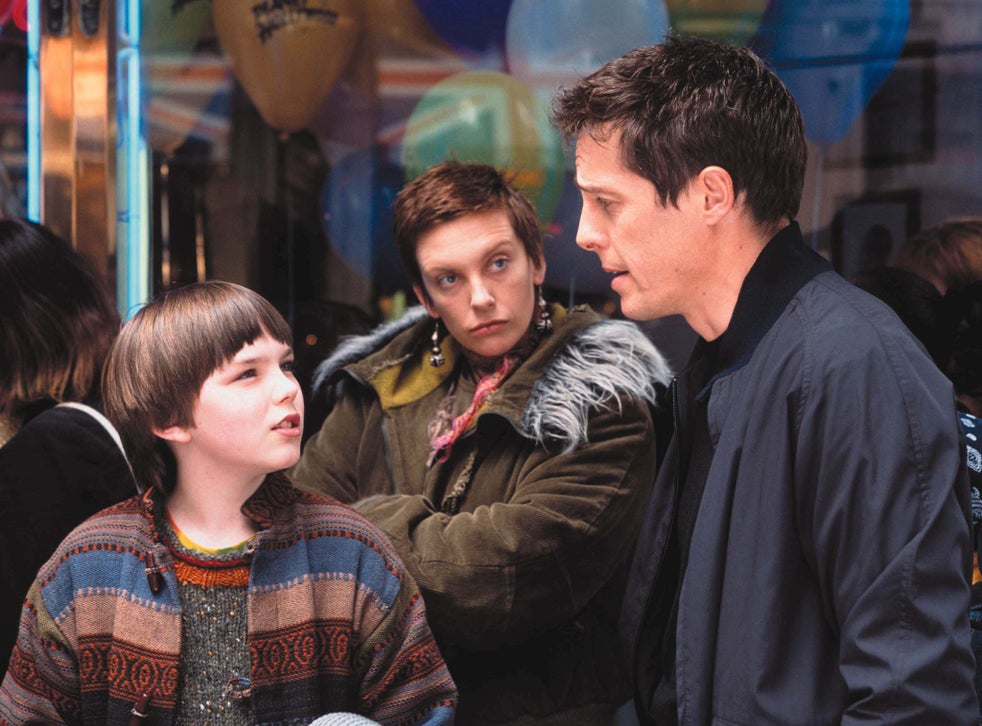 Nicholas Hoult, Hugh Grant and Toni Collettein About a Boy