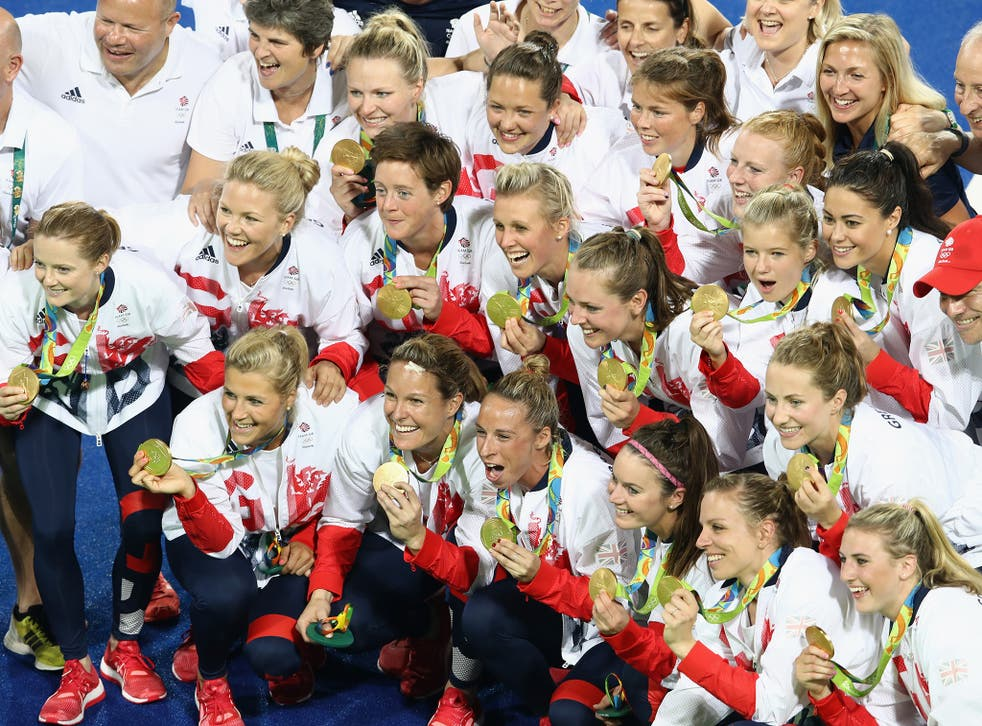Team Great Britain pose with their gold medals after defeating the Netherlands