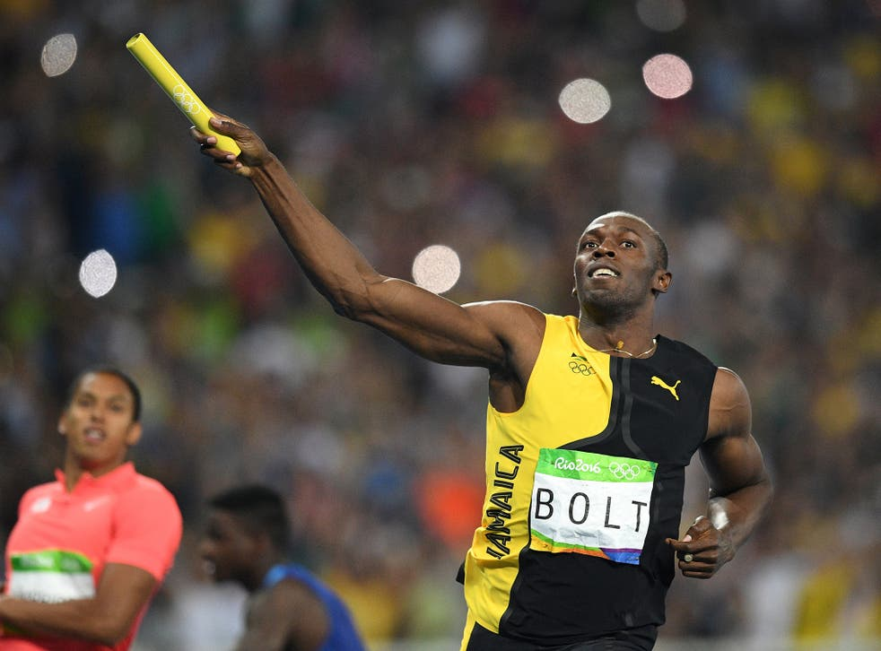 Bolt celebrates after crossing the line first in the men's 4x100m relay