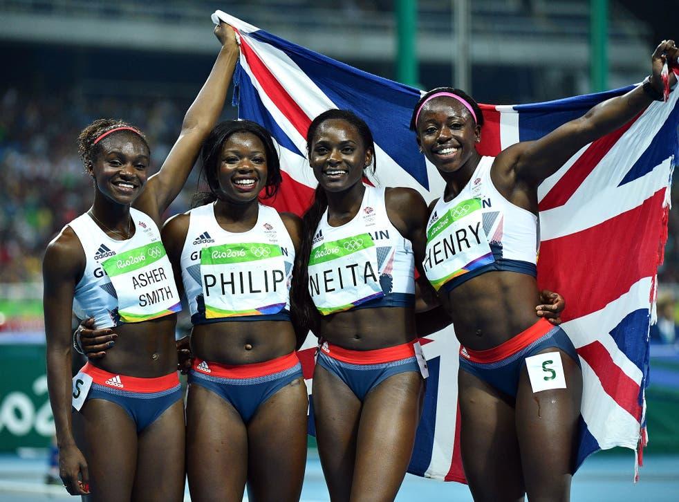 Great Britain's Dina Asher-Smith, Asha Philip, Daryll Neita and Desiree Henry celebrate taking bronze