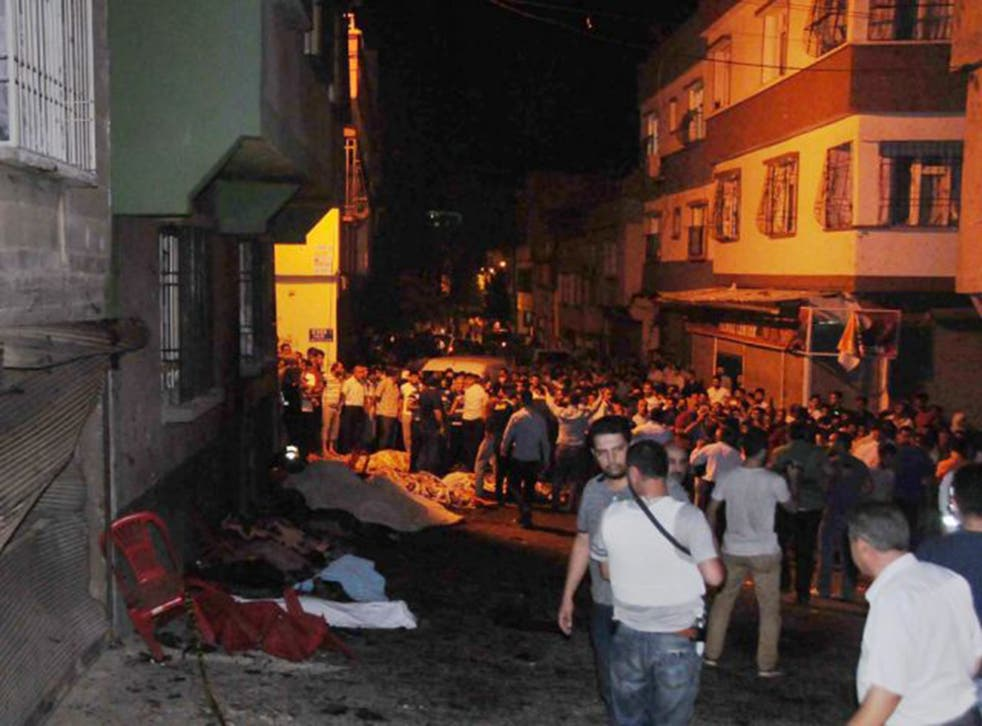 People help the wounded last night in Gaziantep after a suicide bomber targeted a wedding