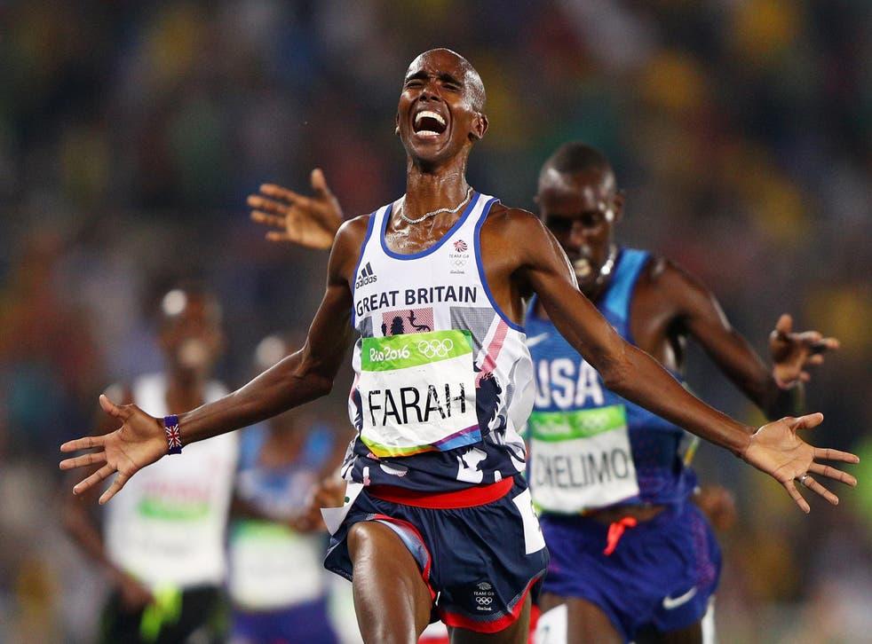 Mo Farah celebrates as he crosses the line
