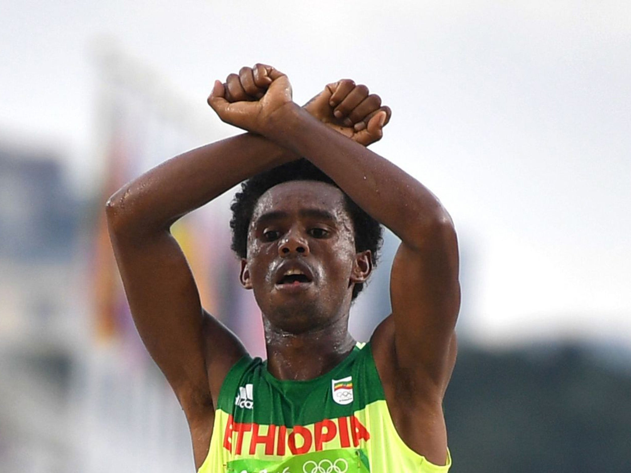 Ethiopian marathon runner could go to jail for anti-government protest on the finishing line