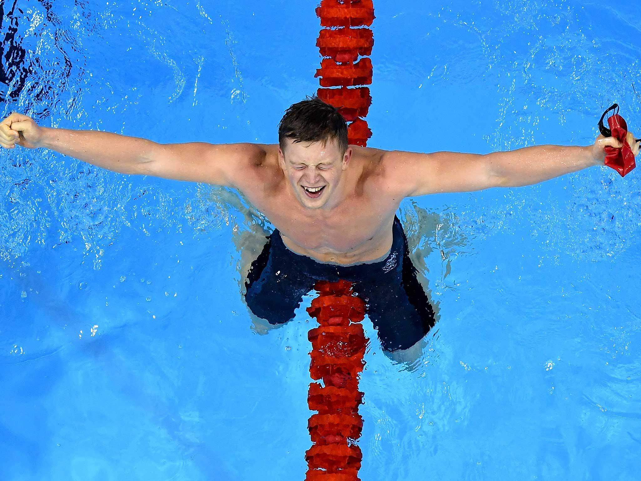 Adam Peaty celebrates his record-breaking gold medal