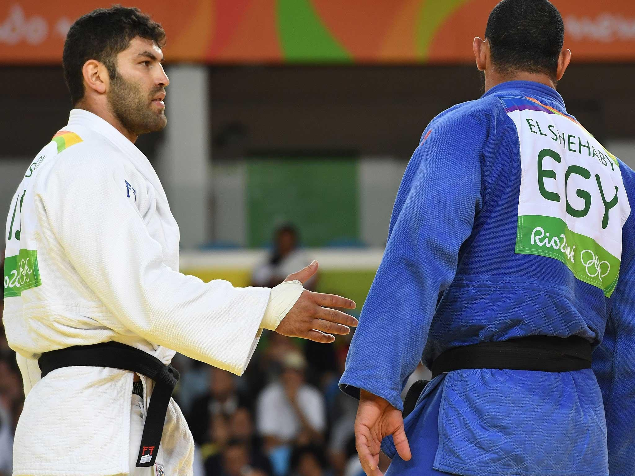 Islam El-Shehaby was sent home for refusing to shake his opponent's hand