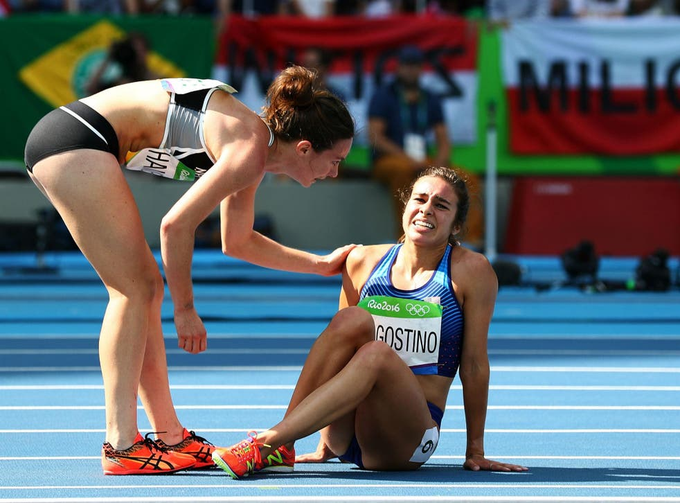 Hamblin tends to D'Agostino after the pair fell during the 5,000 metre qualifier