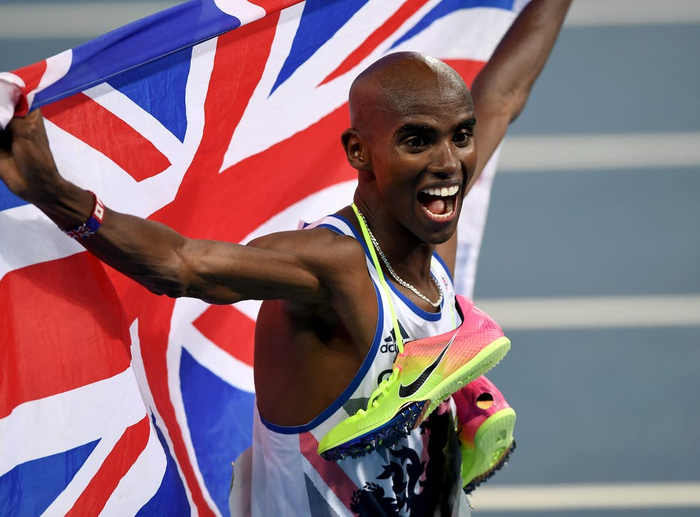 Farah celebrates with a Union Jack after his 5,000m win